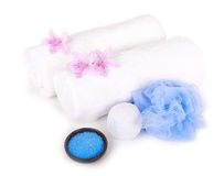 White towels, salt, bath sponge and aromatic flowers Royalty Free Stock Image