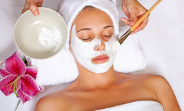 Spa face mask. Woman at spa having relaxing face mask Stock Photo