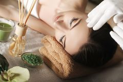 Spa. Face massage. Spa skin and body care. Close-up of young wom. An getting spa massage treatment at beauty spa salon. Facial beauty treatment Stock Images