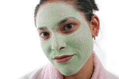 Spa and facial. Close up of womans face with green facial mask Royalty Free Stock Photography