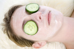 Spa facial with cucumber Stock Image