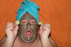 Spa and facials. Funny fat man and clay mask. Beauty requires sacrifice Royalty Free Stock Photo