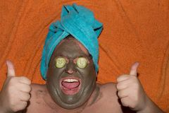 Spa and facials. Funny fat man and clay mask. Beauty requires sacrifice Stock Photos