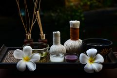 Spa feet and hand thai massage compress balls, herbal ball on the wooden with treatments spa ,. Summer day,Thailand. Healthy Concept Royalty Free Stock Photography