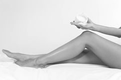 Spa female legs treatment with sea salt Stock Photo