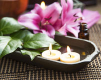 Spa Floating Burning Candles and Lilies Royalty Free Stock Photos