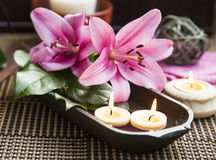 Spa Floating Burning Candles and Lilies Stock Photos