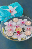 Spa with floating orchideas  and candles Stock Images