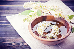 Spa. Flowers in bowl of water for the spa salon Stock Photos