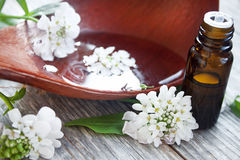 Spa flowers and essence bottle Stock Photo