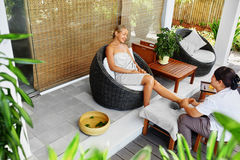 Spa Foot Massage. Body Care Treatment. Woman Relaxing In Salon Royalty Free Stock Photography