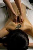 Spa Full Body Massage. Full body massage at day spa salon Stock Photos