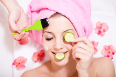 Spa fun: closeup image of funny girl beautiful blond young woman having multi treatment procedures happy smiling eyes closed Royalty Free Stock Photography