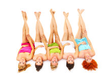 Spa fun. A picture of five girl friends having fun in spa over white background Stock Photos
