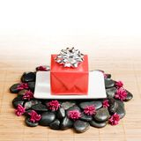 Spa Gift. Gift in a spa like setting, on top of rocks Royalty Free Stock Photo