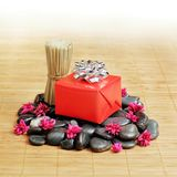 Spa Gift. Gift in a spa like setting, on top of rocks Stock Photography