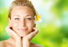 Spa Girl. Beautiful Spa Girl with Frangipani flowers over nature background Royalty Free Stock Images