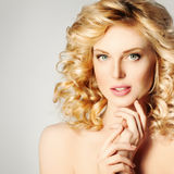 Spa Girl. Beautiful Blonde Woman with Curly Hair Royalty Free Stock Photography