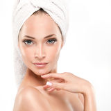 Spa Girl  with clean skin. Beautiful Young Woman After Bath Touching Her Face Royalty Free Stock Photography
