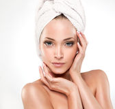 Spa Girl  with clean skin. Beautiful Young Woman After Bath Touching Her Face Royalty Free Stock Photos
