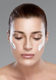 Spa Girl with Cream on Her Face. Skincare concept Royalty Free Stock Image