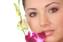 Spa girl with orchid portrait Royalty Free Stock Photography