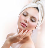 Spa Girl. Skincare. Beautiful Young Woman After Bath Touching Her Face Stock Images