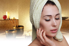 Spa girl in white towel turban on spa background. Skin care. Stock Images