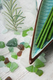 Spa green aromatic sticks and stones Royalty Free Stock Image