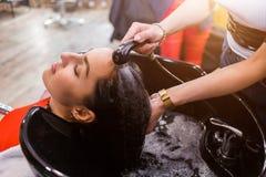 Spa hair treatment brunette women in the salon, close-up, hair salon. Spa hair treatment brunette women in the salon, closeup, hair salon royalty free stock photos