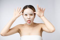 Spa, healthcare. Asian girl with a cosmetic mask isolate on white. Spa, healthcare. Asian girl with a cosmetic mask isolate on white stock image