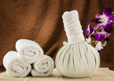 Spa herbal ball, towels and orchid on bamboo mat Stock Images