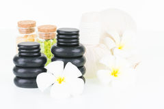 Spa with herbal compress balls, hot stones, bath salt and flowers Royalty Free Stock Image