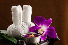 Spa herbal compressing ball with candles and orchid Royalty Free Stock Photography
