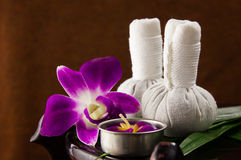 Spa herbal compressing ball with candles and orchid Stock Images