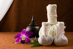 Spa herbal compressing ball with wooden casket and orchid. Stock Photos