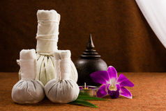 Spa herbal compressing ball with wooden casket and orchid. Royalty Free Stock Images