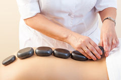 Spa Hot Stone Massage Stock Photo