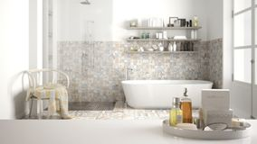 Spa, hotel bathroom concept. White table top or shelf with bathing accessories, toiletries, over blurred vintage classic bathroom,. Modern architecture interior stock photos