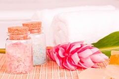 Spa on a hotel bed with  pink  flower close up Royalty Free Stock Images