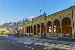 Spa house with Cat statue and Mountains of Bad Ragaz Royalty Free Stock Photos