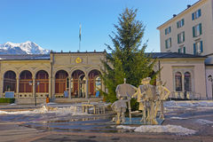 Spa house with People monument and Mountains in Bad Ragaz Stock Photos