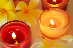 Spa image. Frangipani flowers and lit candles stock photos