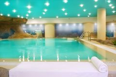 Spa indoor turquoise water white towel Stock Image