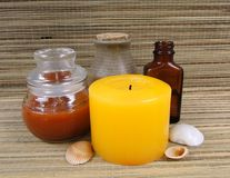 Spa items. Candles, bottle, jar and shells with straw backgound Stock Photo