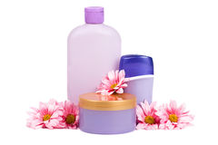 Spa Items. Cosmetic bottles and flowers over white stock photo