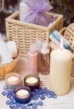 Spa items composition. A spa collection image - bathroom items with three candles in the foreground stock image