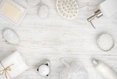 Spa items and cosmetics on wood, copy space in center Royalty Free Stock Photo