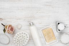 Spa items and decorative cosmetics on wooden background, top view.  royalty free stock images