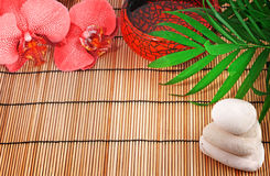 Spa items. Orchid, stones, palm, water Royalty Free Stock Photography
